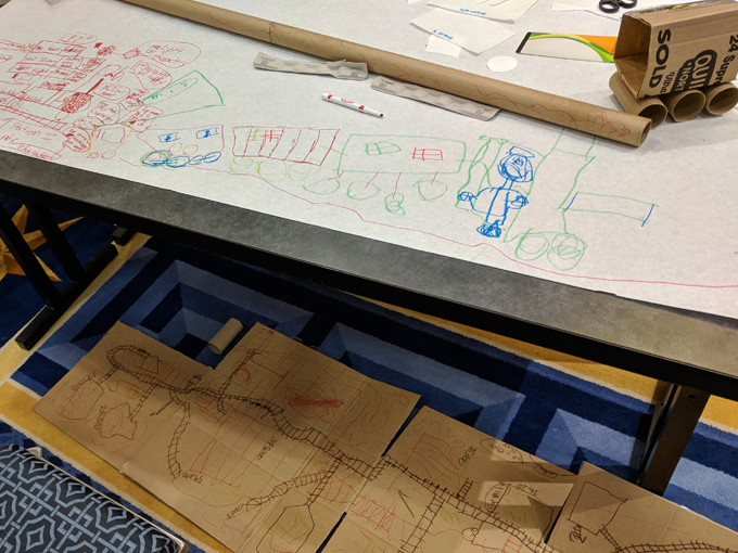 A train game created by two kids made out of paper, cardboard and pens.