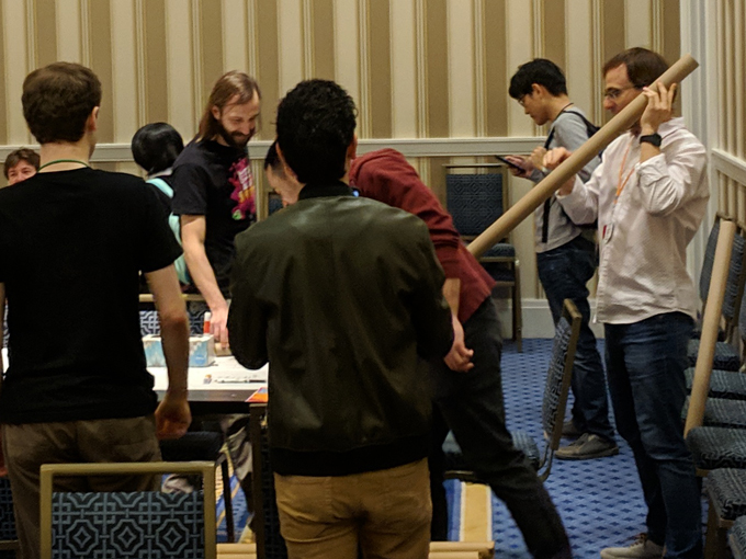 Chip tries out one of the devs prototypes by lifting a cardboard tube about to put a marble inside.