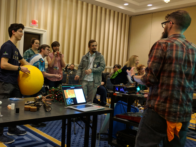 Ocean works with a group at his panel to make sound effects for one of our cartoon loops.